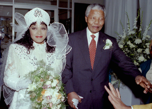 African National Congress President Nelson Mandela escorts his daughter Zinzi to church October 24,