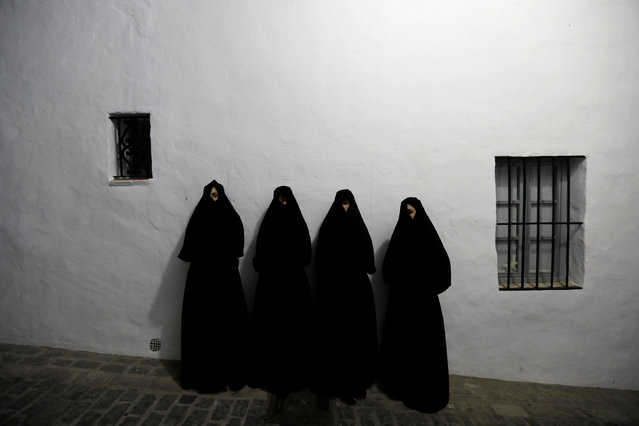 "Women wearing ""Cobijada"" outfits pose for a portrait in Vejer de la Frontera, southern Spain Septemb"
