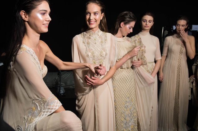 Models backstage ahead of the Zareena presentation during Fashion Forward Spring/Summer 2017 at the