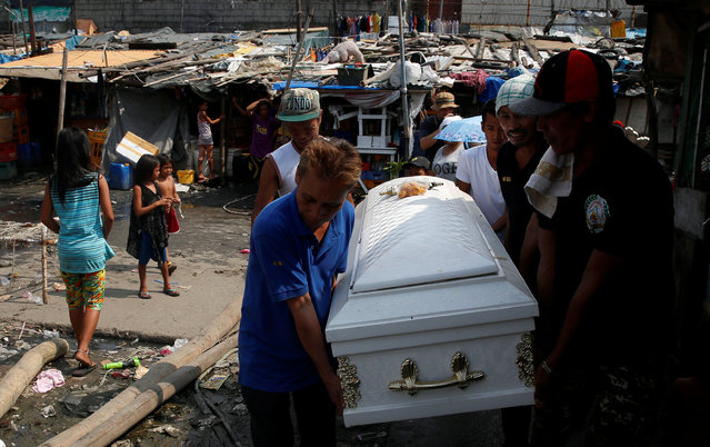 Mourners carry the coffin of Vicente Batiancila in a slum district where he lived, whom police said