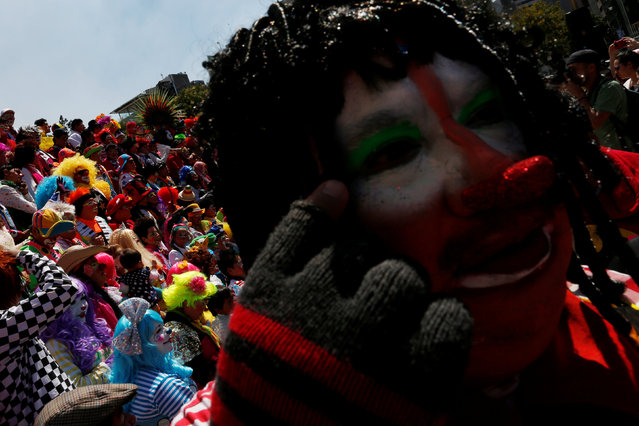 Clowns poses for the annual picture as part of the XXI Convention of Clowns, at the Monument to the