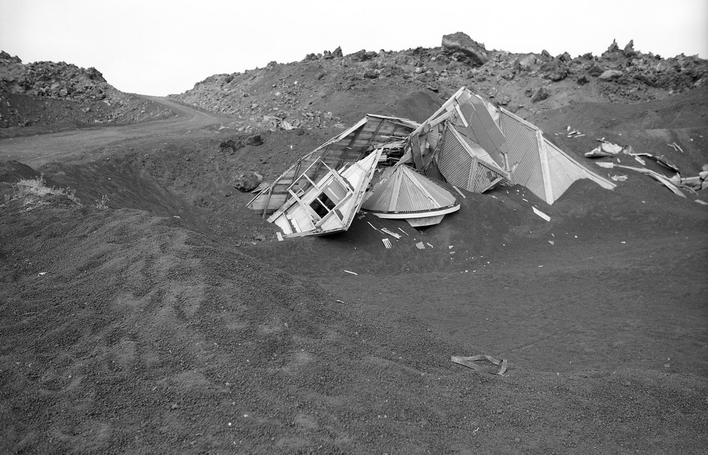 24 июля 1974. Разрушенные дома на острове Хеймаэй