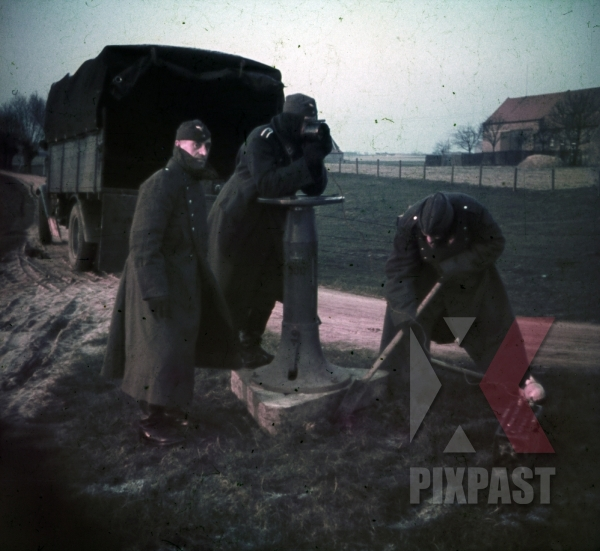 stock-photo-dunkirk-france-winter-1940-luftwaffe-flak-soldiers-shovel-aircraft-viewer-winter-boots-jacket-9717.jpg