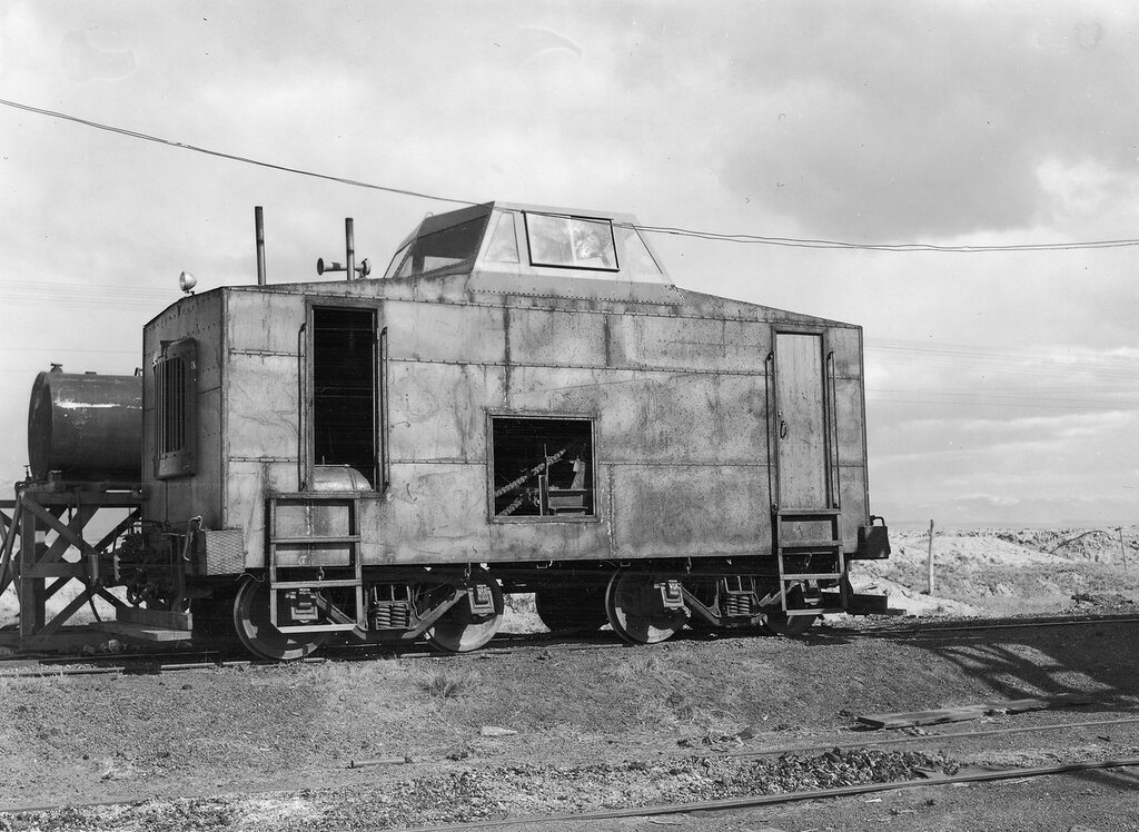 Homemade diesel locomotive used by the Southern San Luis Valley Railroad Company parked in Blanca (Costilla County), Colorado. 1955 May 27.
