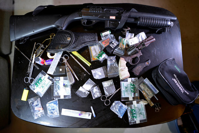 Weapons, shabu (Metamphetamine Hydrochloride) and other drug paraphernalia are pictured inside a hou