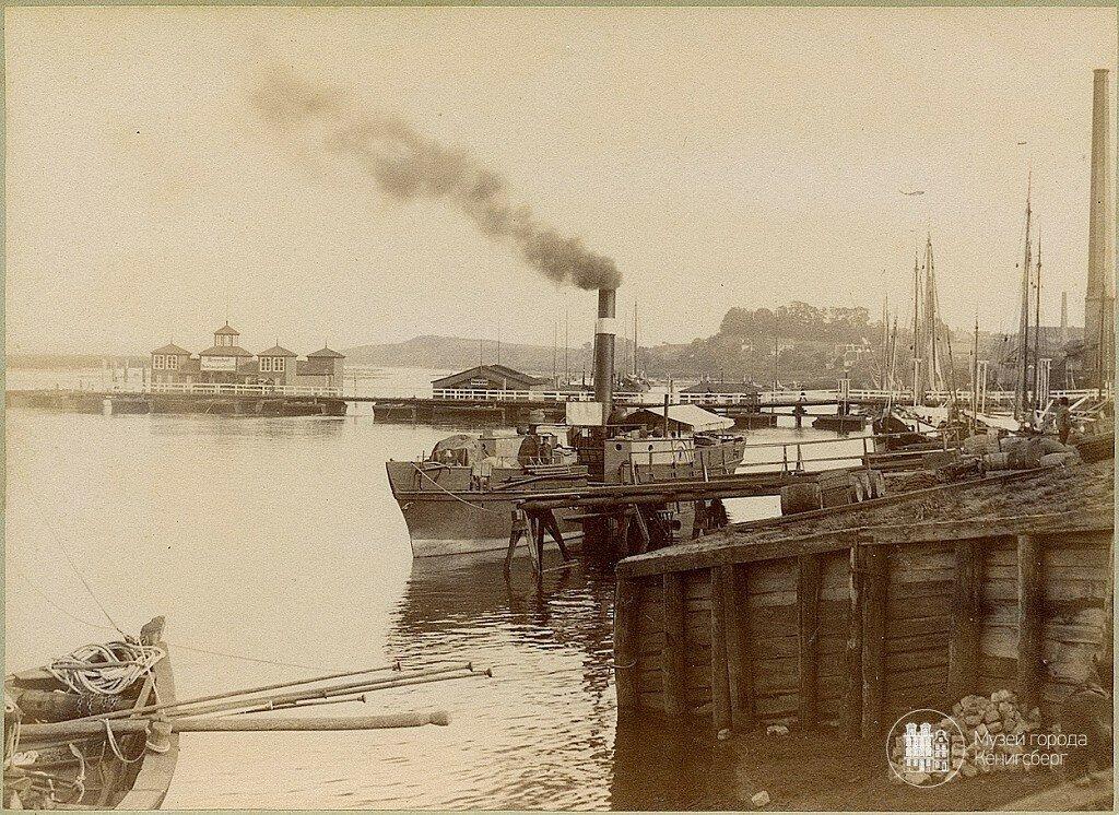 1878-1879 Тильзит. Порт и вид на старый мост через Мемель.jpg