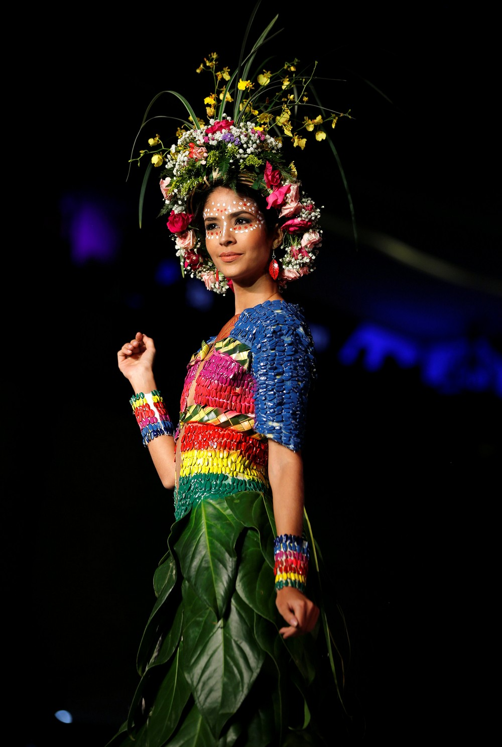 A model presents a creation during the Biofashion show, which features designs made from plants, recycled and natural materials, in Cali