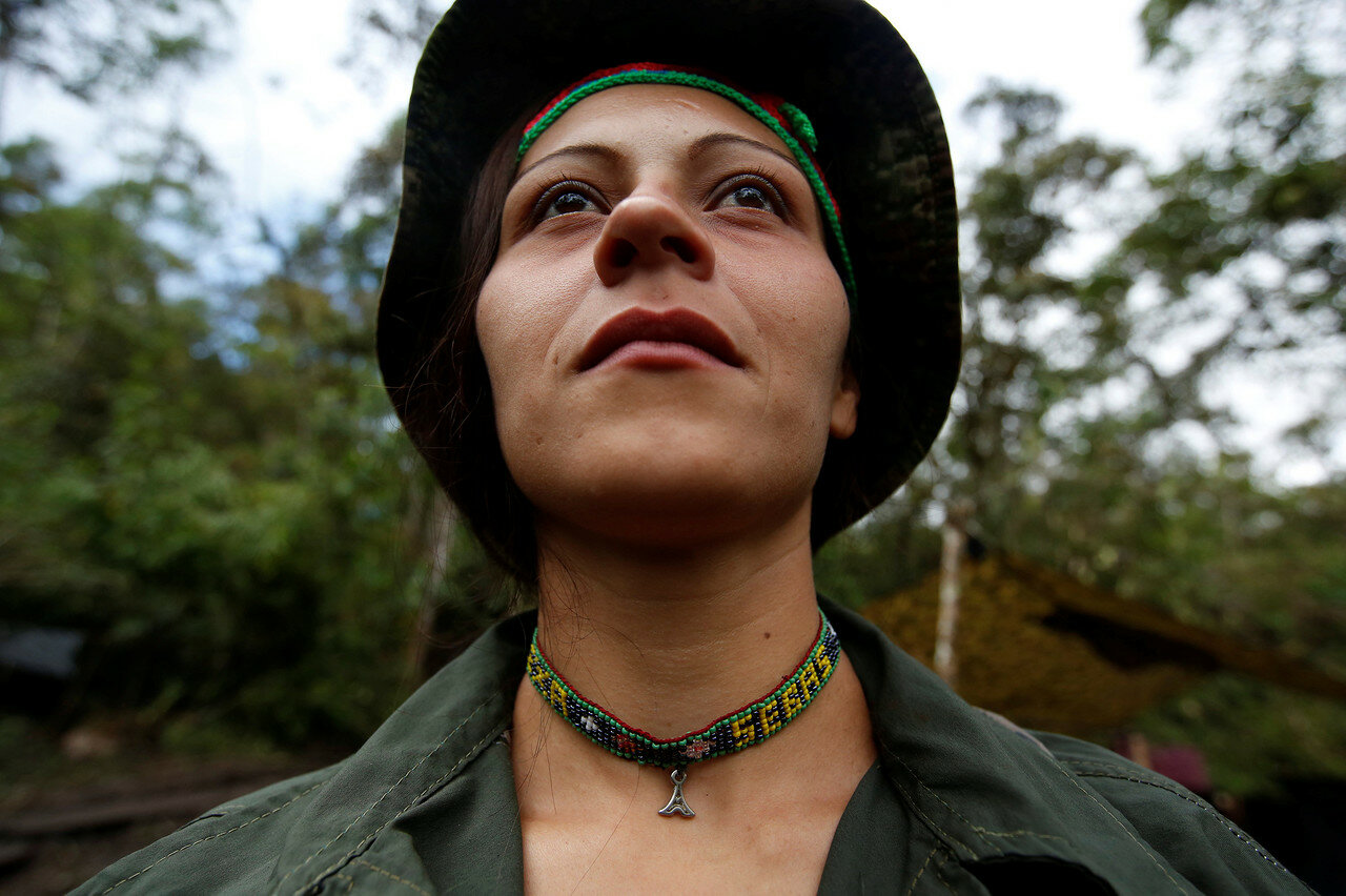Alexandra, a member of the 51st Front of the Revolutionary Armed Forces of Colombia (FARC), poses for a picture at a camp in Cordillera Oriental