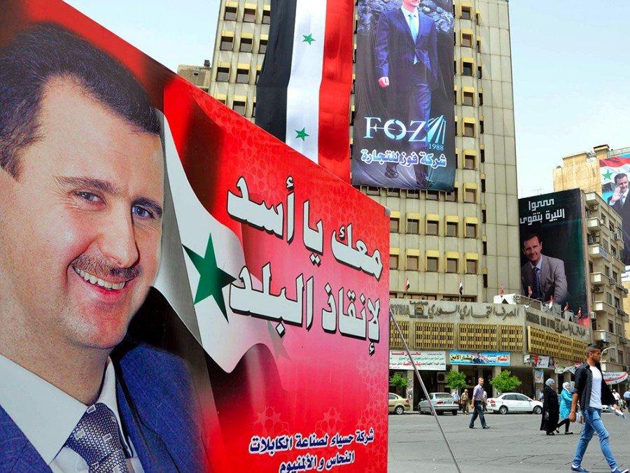Асад выступил против ограничения собственных полномочий впроекте конституцииРФ