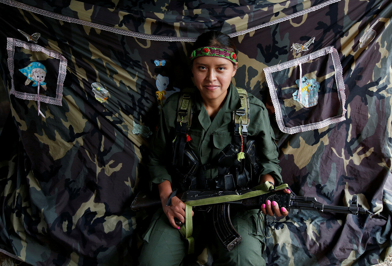 Leidi, a member of the 51st Front of the Revolutionary Armed Forces of Colombia (FARC), poses for a picture at a camp in Cordillera Oriental
