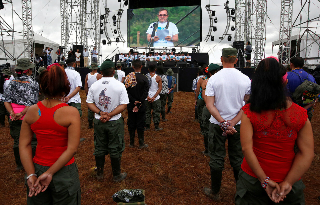 FARC rebel leader Rodrigo Londono, better known by his nom de guerre Timochenko, is seen on a screen during the opening of ceremony congress at the camp where they prepare for ratifying a peace deal with the government, near El Diamante in Yari Plains