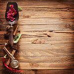 Image texture of old wooden boards with kitchen spices.