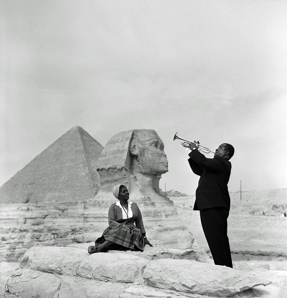 Louis Armstrong plays for his wife in front of the Sphinx by the pyramids in Giza, 1961