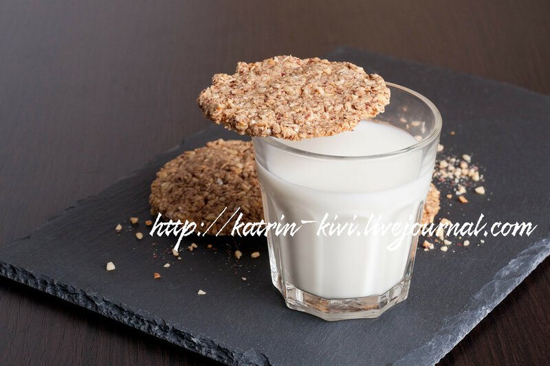glass of milk and oat cookies on a dark background