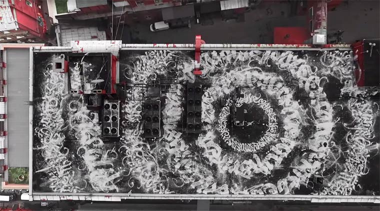 Rooftop Calligraphy - A massive street art creation by Pokras Lampas