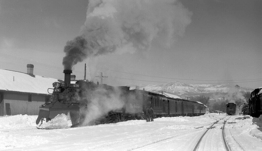 Denver & Rio Grande Western train (Narrow Gauge), engine number 476, engine type 2-8-2. Train #215, Chama, N.M., February 13, 1948.
