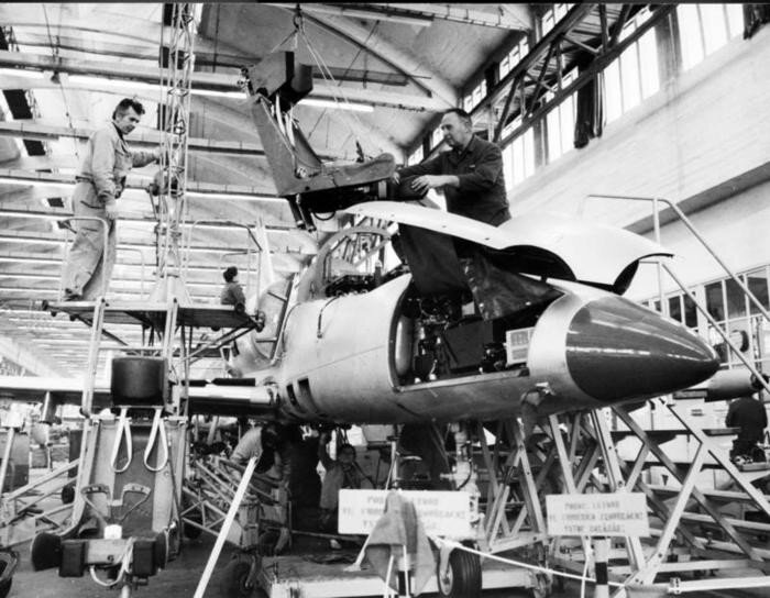AERO workers Frantisek Janu and Josef Saska assembling the pilot seat into L-39 ALBATROS plane.