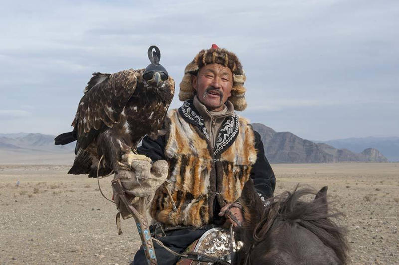 Portrait of Kazakh eagle hunter.