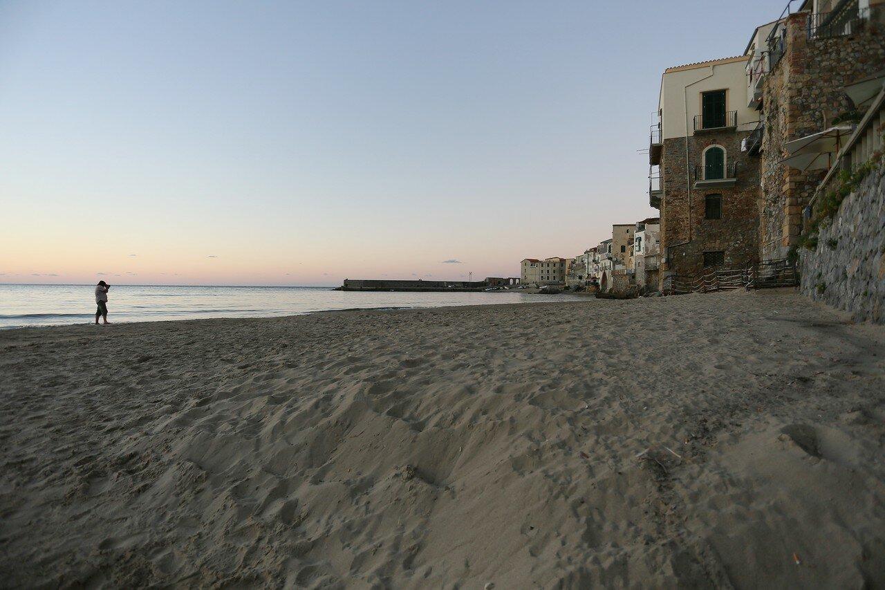 Cefalu. Sunset on the beach. Last day of the season