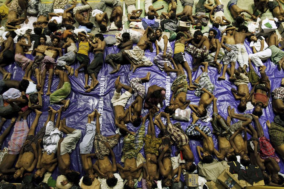 18. Мигранты из Африки доплыли до итальянского острова Лампедуза, 31 мая 2015. (Фото Mauro Bucc