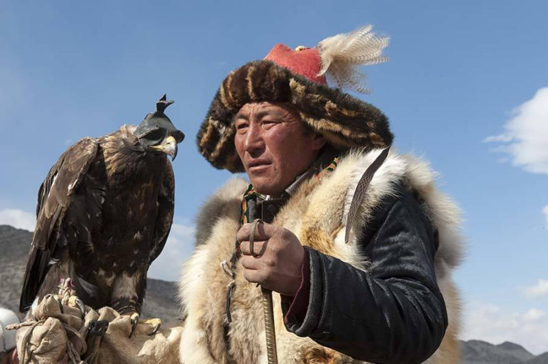 Portrait of Kazakh eagle hunter at the Golden Eagle Festival on the festival grounds near Ulgii.