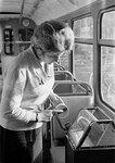 Фото И. Озерского 1964 Водитель московского трамвайного парка Е. Потапова перед выходом на линию заправляет билеты в кассу.jpg