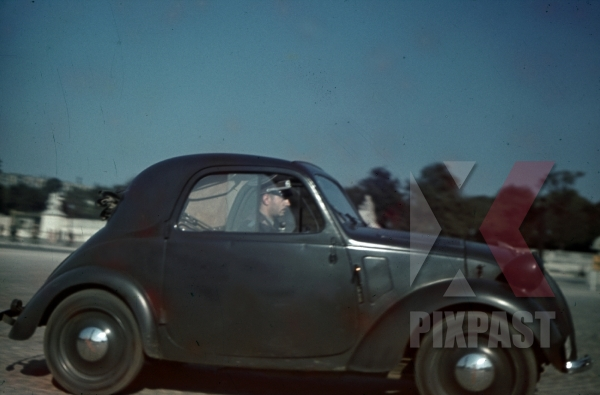 stock-photo-paris-france-1940-red-cross-officer-fiat-500-topolino-wehrmacht-gray-8299.jpg