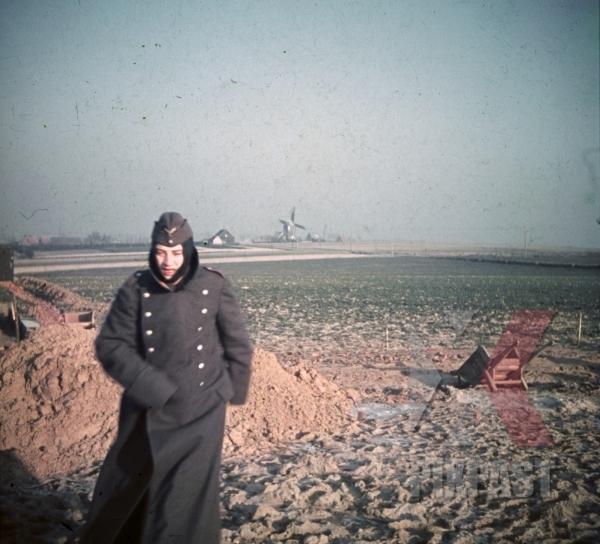 stock-photo-winter-1940-france-luftwaffe-air-force-flak-soldier-jacket-bunker-building-windmill-9733.jpg