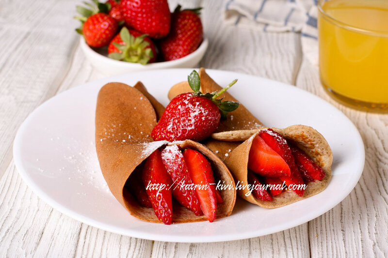 crepes with berries and orange juice, horizontal, closeup