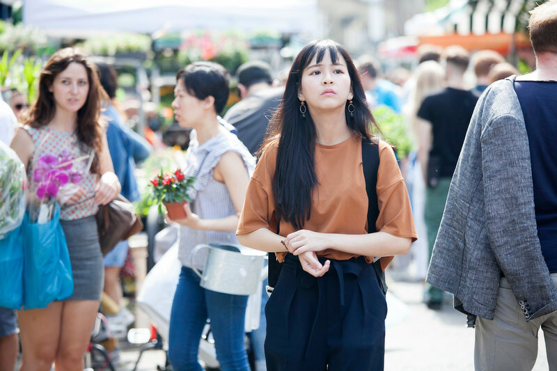 Columbia Road Flower Sunday market. Street traders are selling their stock. People with flowers in their hands