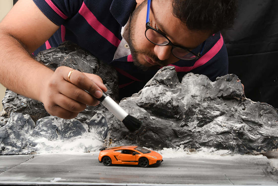 Photographing miniature cars rather than real cars