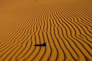 не объяснённое нахождение камни на дюне