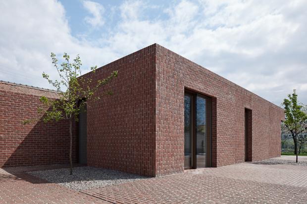 Brick House in Brick Garden by Jan Proksa