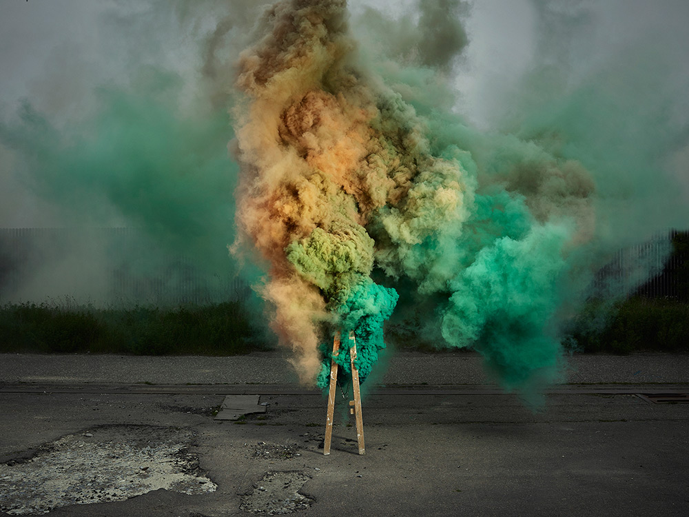 New Smoke-Based Photographs by Ken Hermann Capture Colorful Bursts Rising From an Industrial Corridor
