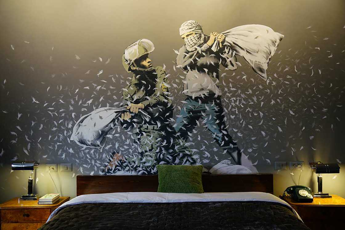 Banksy opens a real hotel for its new exhibition Walled Off! (18 pics)