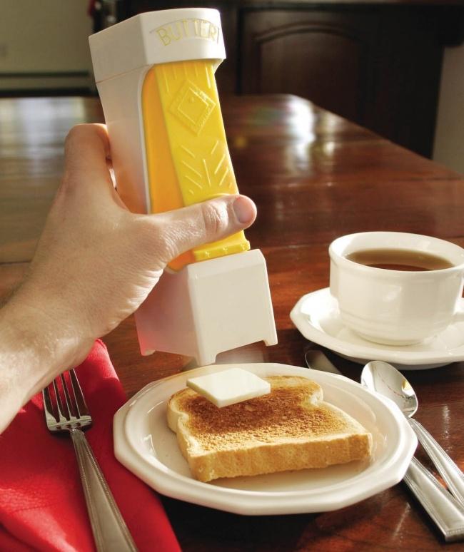 © amazon  Загрузить брусок масла вприбор, надавить на«клавишу»— итоненький ломтик оказывае