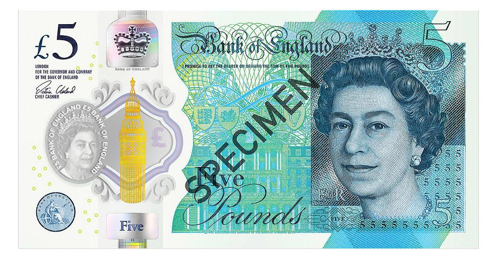 12. Банкнота 10 000 тенге , выпущенная в Казахстане в 2003 году, со снежным барсом на фоне гор.