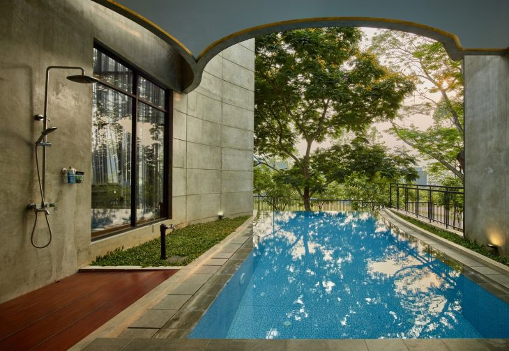 Located in The Green Precinct, Bumi Serpong Damai, Tangerang, Kampono House sited on the corner of t
