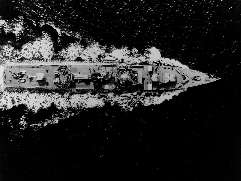 Aerial overhead view of a Soviet RIGA class ocean escort, photographed at 1405 hours Zulu time 25 June 1963, in the Danish Store Belt area of the Western Baltic Sea. The ship was wearing pennant number 202 at the time of this photograph.