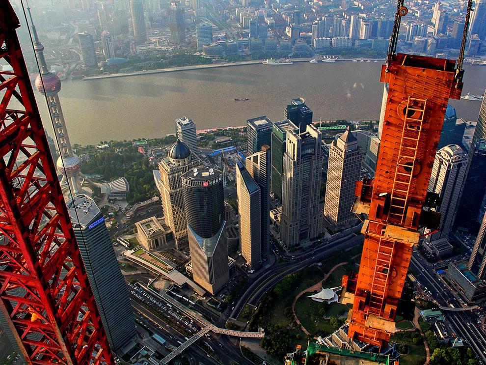 Действительно, в отличие от обычных видов мегаполиса, крановщику Wei Gensheng удалось запечатле
