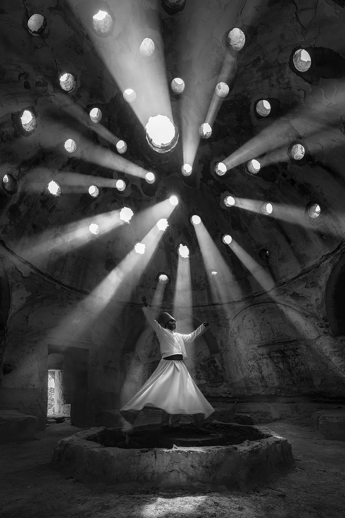 People, 1st place. Photo and caption by F. Dilek Uyar Worship . Whirling Dervish in an historical pl