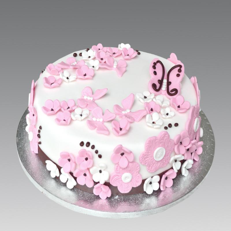 Бело-розовый торт с бабочками и цветами.  С международным днем торта!