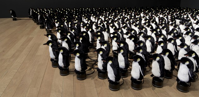 Interactive Mirror Built from 450 Rotating Penguins
