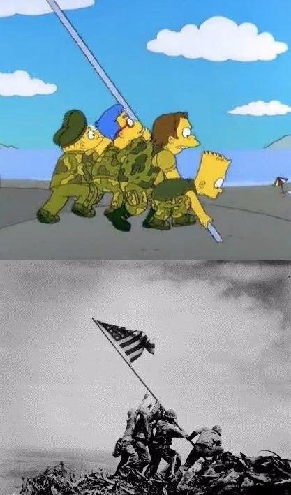 Фотография исторического момента, когда американские пехотинцы устанавливали флаг США, запечатлел во
