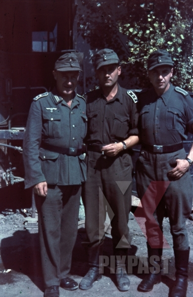 stock-photo-german-wehrmacht-supply-officers-in-tropical-uniform-caps-boots-smoking-repair-truck-anzio-italy-1944-9807.jpg