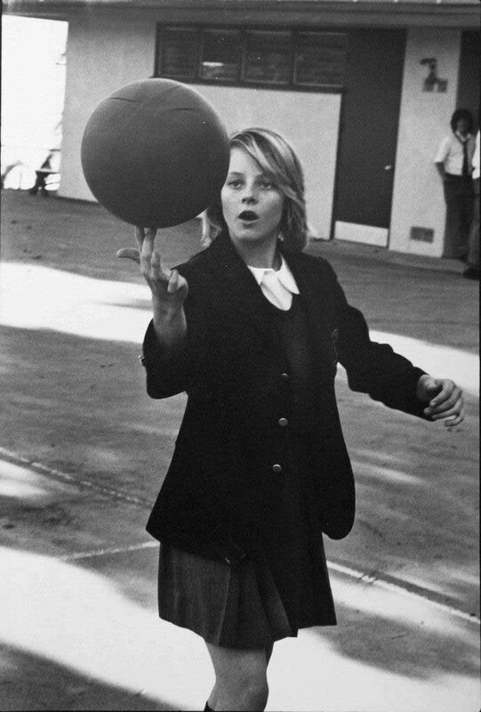 14-year-old Jodie Foster showing off her basketball skills in her school uniform at Lycée François de Los Angeles, 1976.jpg