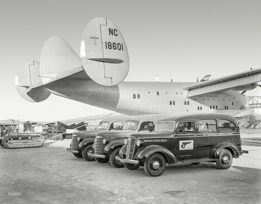 "Aug. 28, 1939. ""Golden Gate International Exposition, San Francisco. General Motors exhibit of GMC trucks with Pan American Airways Clipper Ship at Treasure Island"