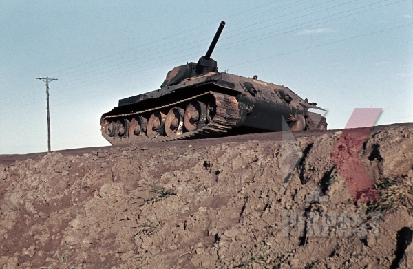 stock-photo-captured-russian-t34-panzer-tank-near-beresina-1941-3rd-panzer-division--12273.jpg