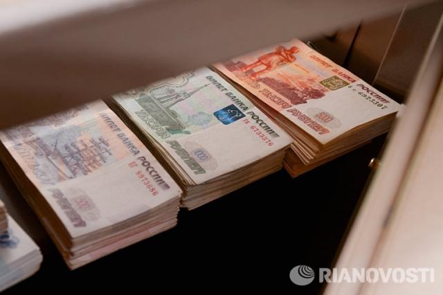 Эксперты Fitch: ЦБпереплатил заспасение проблемных банков 500млрдруб.
