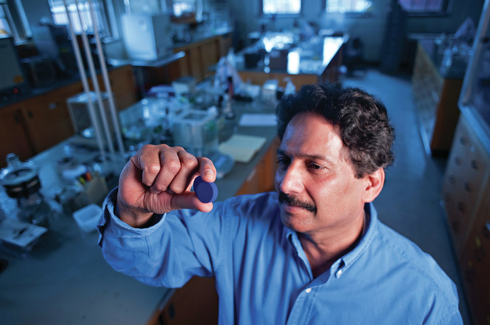 Professor Mas Subramanian gazes at YInMn blue which was discovered in his lab in 2009. (Photo courte